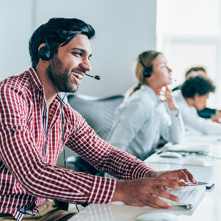 Man in office on handsfree call