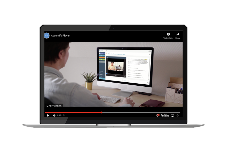 Laptop showing a video of a man using a computer.